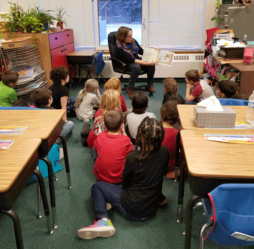 Clara Noomah reading to kids.