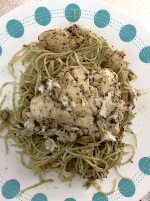 Halibut and noodles on a polka dot plate.